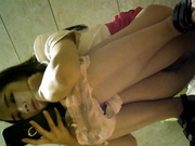 KTV夜场厕所偷拍.极品长腿女神,包臀齐B裙,看着手机傻笑